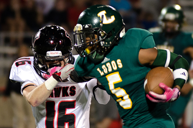 LOBO's Justin Spady runs the ball against Rockwall Heath at Longview.